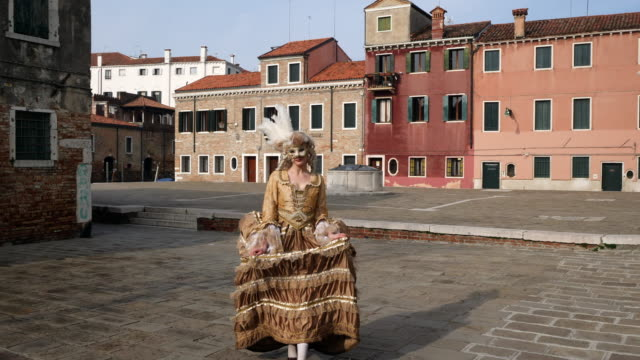woman wearing historical clothing and venetian mask in old town - historical clothing stock videos & royalty-free footage