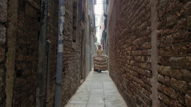 woman wearing historical clothing walking in narrow alley in old town - historical clothing stock videos & royalty-free footage