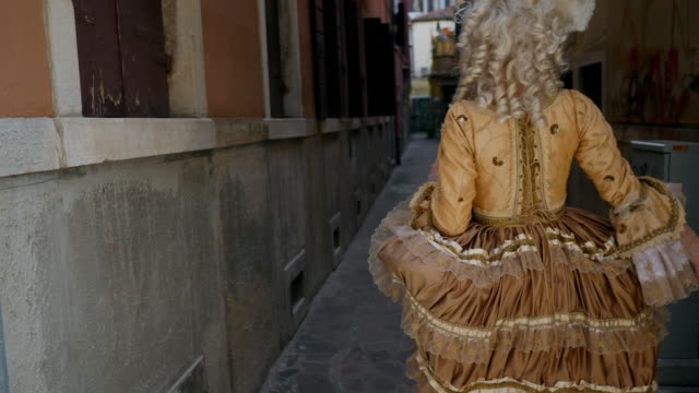 woman wearing historical clothing walking in narrow alley - historical clothing stock videos & royalty-free footage