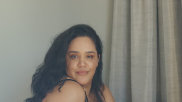 Woman wearing lace bodysuit