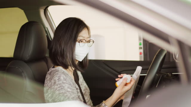 woman wearing mask at drive-through pharmacy - convenience stock videos & royalty-free footage