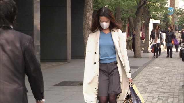 MS ZO TD Woman wearing pollution mask on street, Tokyo, Japan