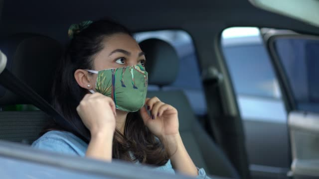 woman wearing protective mask inside the car - mesquita stock videos & royalty-free footage
