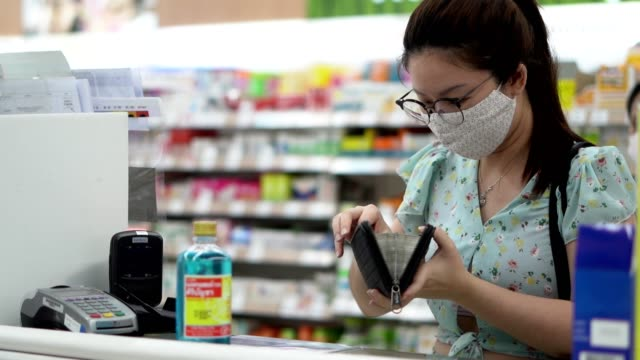 woman wearing protective mask preparing for virus pandemic spread quarantine - checkout stock videos & royalty-free footage