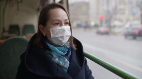 woman wearing protective medical mask in bus - bus stock videos & royalty-free footage