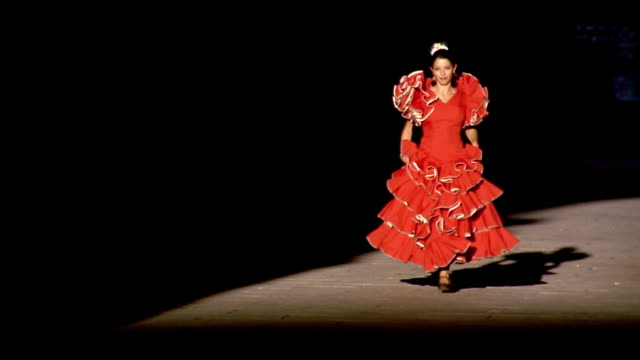 woman wearing red flamenco dress running on sidewalk toward camera / madrid, spain - flamenco dancing stock videos and b-roll footage