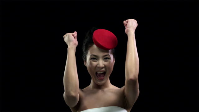 woman wearing red hat clapping and cheering - exhilaration stock videos and b-roll footage
