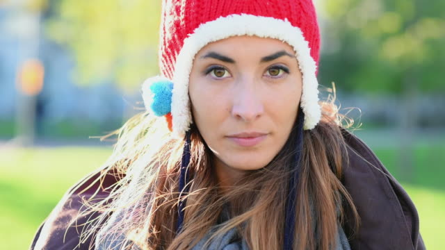 woman wearing red knit hat - woolly hat stock videos and b-roll footage