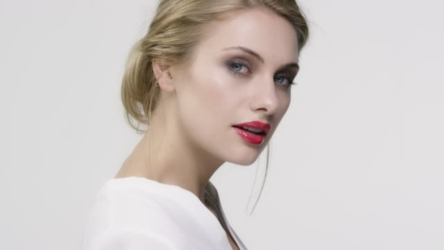 woman wearing red lipstick looking away - red lipstick stock videos & royalty-free footage