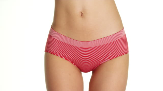 vídeos de stock e filmes b-roll de woman wearing red striped underwear - umbigo