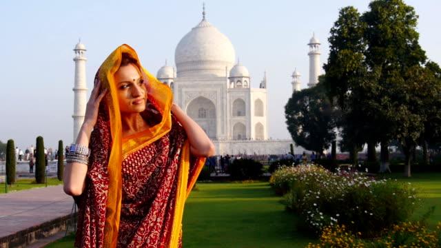 woman wearing sari at taj mahal in india - sari stock videos and b-roll footage