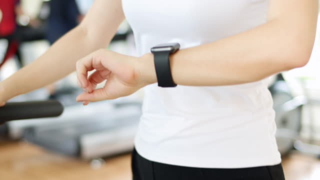 Woman wearing smart watch exercise