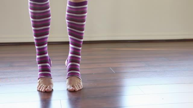 woman wearing striped leg warmers in pilates studio - leg warmers stock videos & royalty-free footage