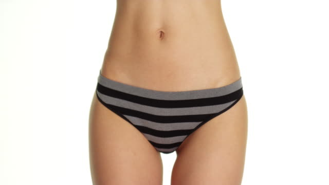 vídeos de stock e filmes b-roll de woman wearing striped underwear - umbigo