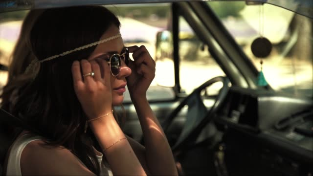 woman wearing sunglasses in van during road trip - hair band stock videos & royalty-free footage