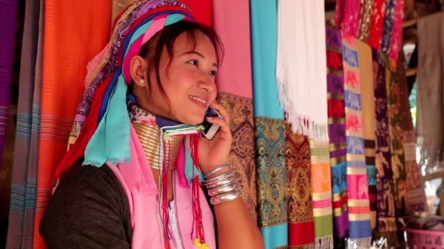 woman wearing the traditional with mobile phone at a weaving in village - weaving stock videos & royalty-free footage