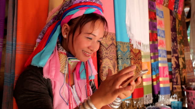 woman wearing the traditional with mobile phone at a weaving in village - indigenous culture stock videos & royalty-free footage