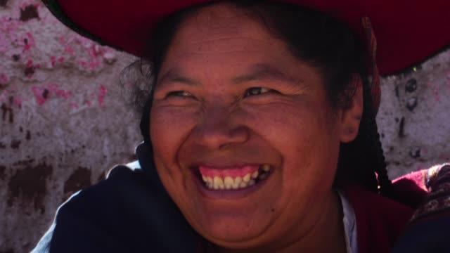 woman wearing traditional hat in chinchero, peru - etnia video stock e b–roll