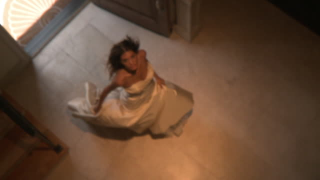 WS SLO MO Woman wearing wedding dress entering in house and spinning / Jacksonville, Florida, USA