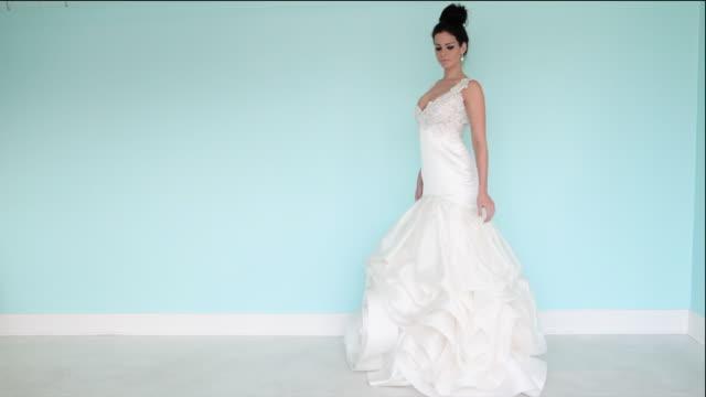 woman wearing wedding dress, studio shot - dress stock videos & royalty-free footage
