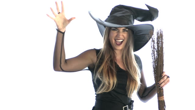 woman wearing witch costume - party hat video stock e b–roll
