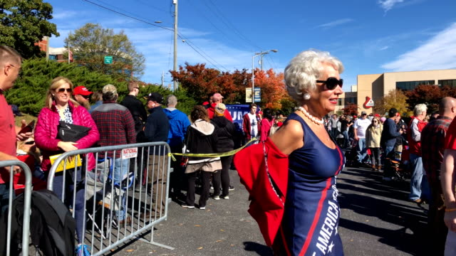 """woman wears a """"make america great again"""" dress as she poses with other trump supporters prior to a campaign rally u.s. president donald trump holds... - midterm election stock videos & royalty-free footage"""