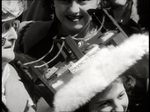 woman wears a model of the brooklyn bridge on her easter bonnet. - brooklyn bridge stock videos & royalty-free footage