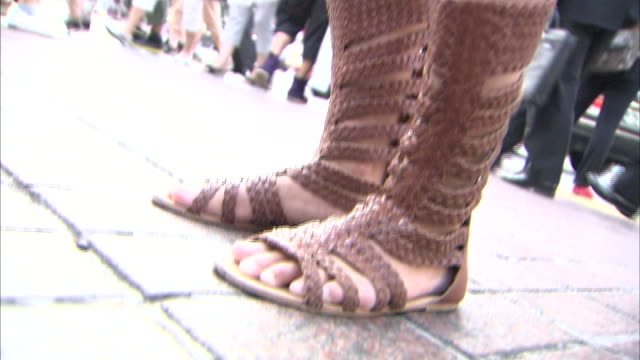 A woman wears a trendy gladiator sandal/The subject is not a professional model but a common passenger/Shot at the Shibuya scramble crossing in...