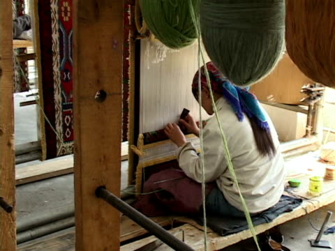 ms, woman weaving carpet in workshop, lhasa, tibet, china - tibet stock videos & royalty-free footage