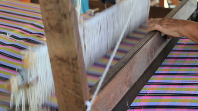 woman weaving cotton on a loom in thailand - weaving stock videos & royalty-free footage