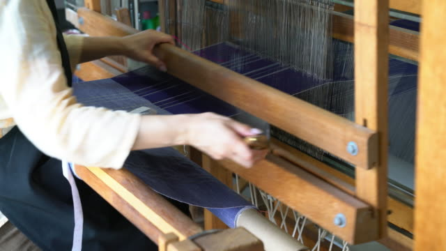 woman weaving fabric, passing the shuttle back and forth - tradition stock videos & royalty-free footage
