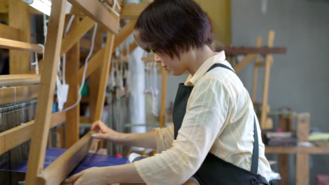 woman weaving fabric, passing the shuttle back and forth - japanese culture stock videos & royalty-free footage