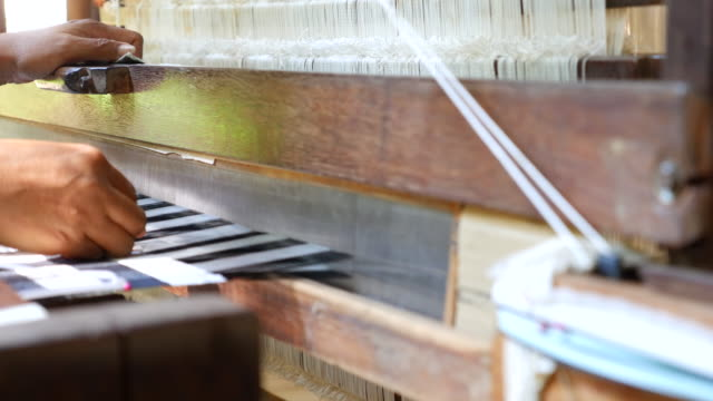 woman weaving silk in traditional - rug stock videos & royalty-free footage