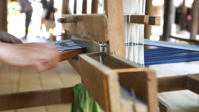 woman weaving silk in traditional way at manual loom - loom stock videos & royalty-free footage