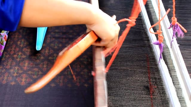 woman weaving thai silk - craft product stock videos and b-roll footage