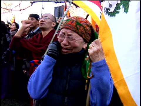 woman weeping during protest of china's treatment of tibet outside chinese embassy/ washington dc/ audio - domination stock videos & royalty-free footage