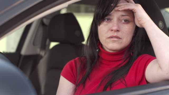 hd: woman weeping in a car - grief stock videos & royalty-free footage