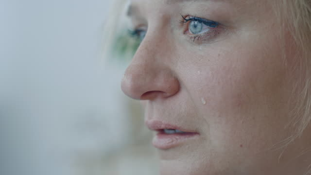 slo mo woman weeping in sadness and grief - abuse stock videos & royalty-free footage