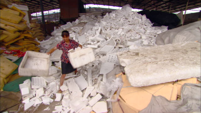 ms cu woman weighing discarded styrofoam at recycling center, beijing, beijing, china - polystyrene stock videos & royalty-free footage