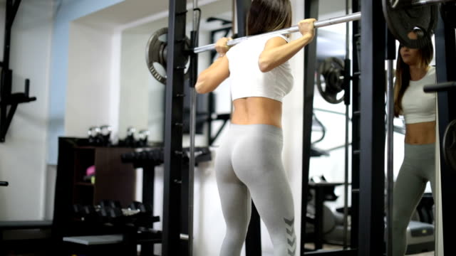 woman weightlifting in gym - mirror stock videos & royalty-free footage