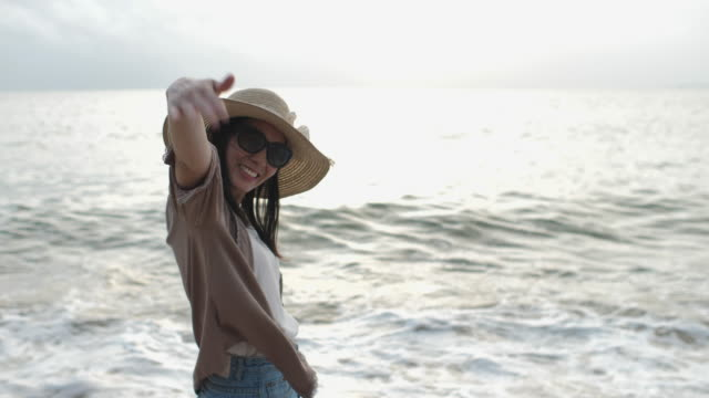 woman welcome you to walk with her on beach - beckoning stock videos & royalty-free footage