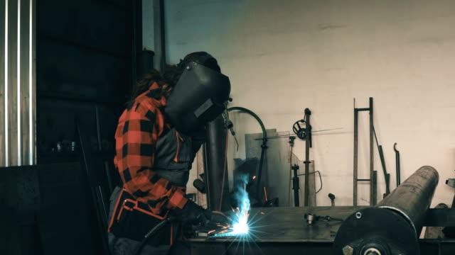 woman welder in workshop 4k - welding stock videos and b-roll footage