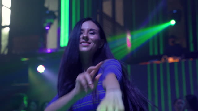a woman who dances in a nightclub merrily during weekends. - stereotypically upper class stock videos & royalty-free footage