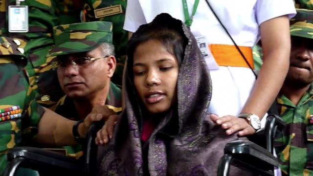 woman who was pulled out from the rubble of collapsed garment factory complex 17 days after it caved in outside the bangladeshi capital said monday... - garment stock videos & royalty-free footage