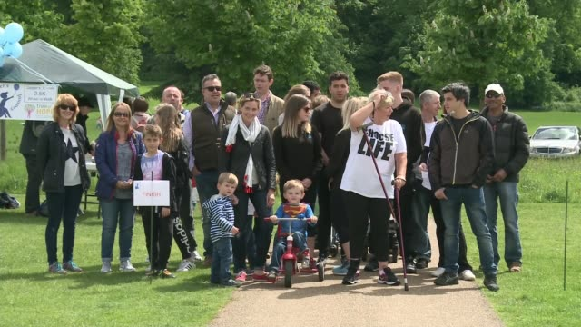 woman who was told she would never walk again takes part in charity walk location unknown ext kate thorntonjones interview sot various shots of... - itv london tonight weekend stock videos & royalty-free footage