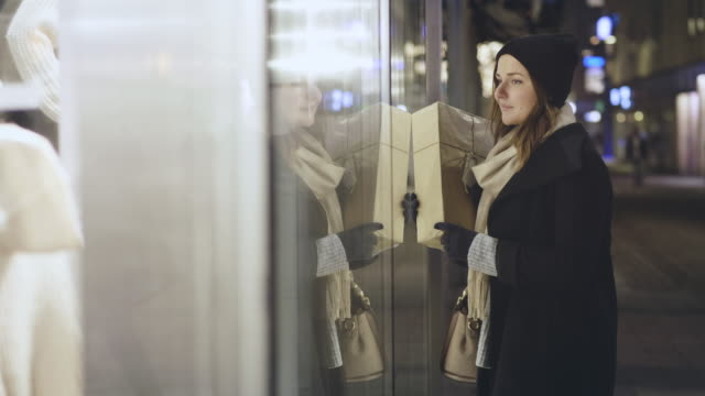 woman window shopping during christmas holiday - window display stock videos and b-roll footage