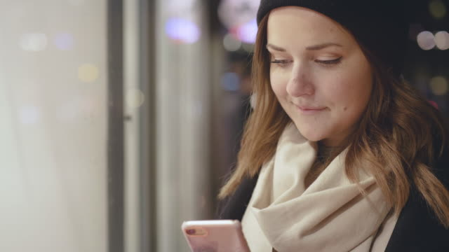 woman window shopping during christmas holiday - scandinavian culture stock videos and b-roll footage