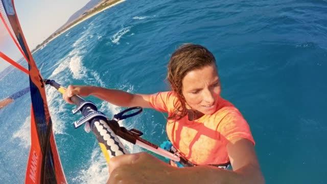 LD Woman windsurfing  in sunshine