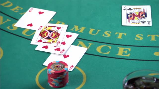 woman winning blackjack in casino - blackjack stock videos and b-roll footage