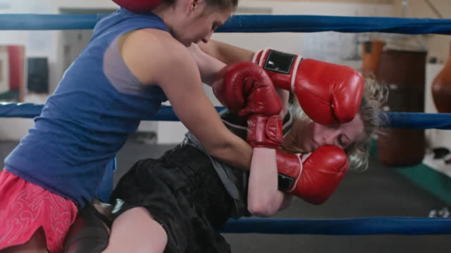 Woman winning in boxing with partner